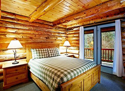 double bed in luxury log cabin
