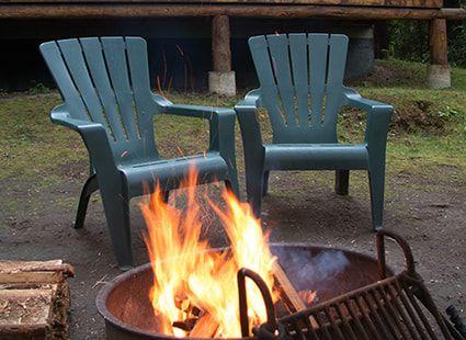 bonfire outside log cabin rental