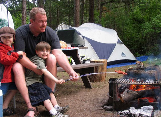 cooking hotdogs at Lakedale's family campsite
