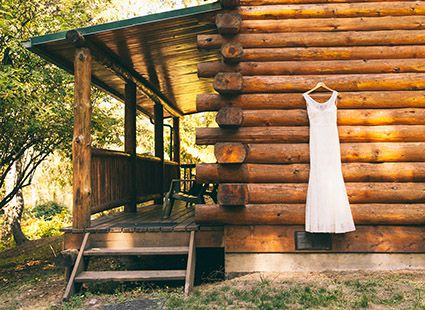 wedding dress on log cabin rental