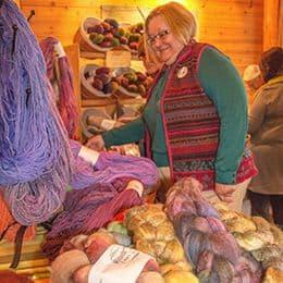 Woman looking at skeins of yarn