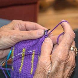 Purple yarn being knit