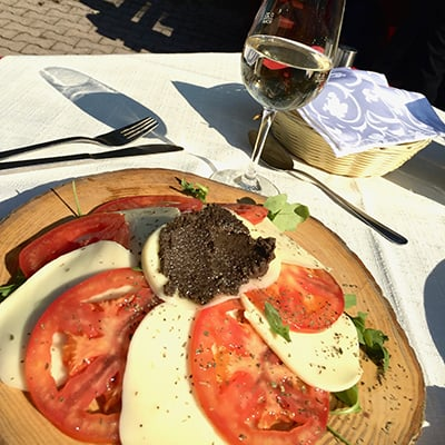 Caprese salad on a wooden plate
