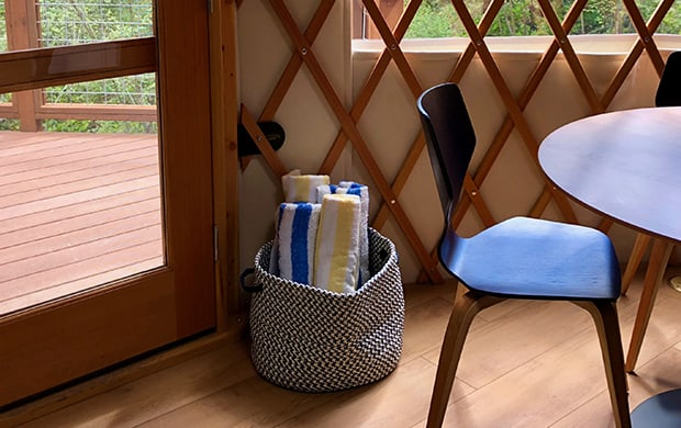 detail towels in basket with chair at 620