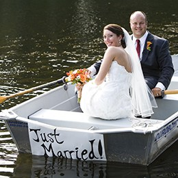 Bride and groom rowing a boat