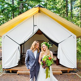Bride and groom in front of a yurt
