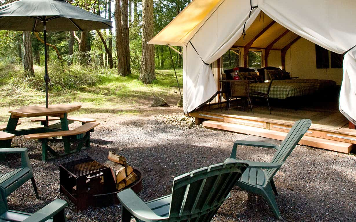 Canvas_Cabin_bunkhouse_exterior_with_campfire_vert_fpiwi6