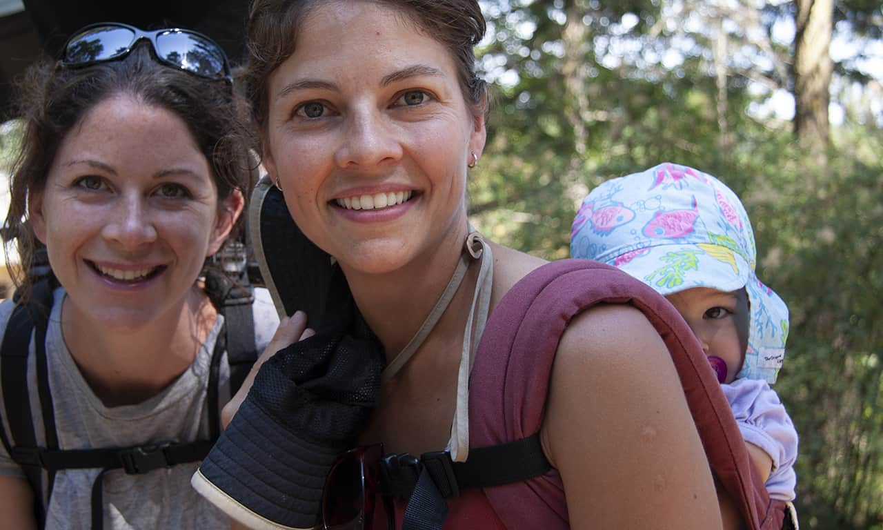 1280 2 moms with baby in backpack