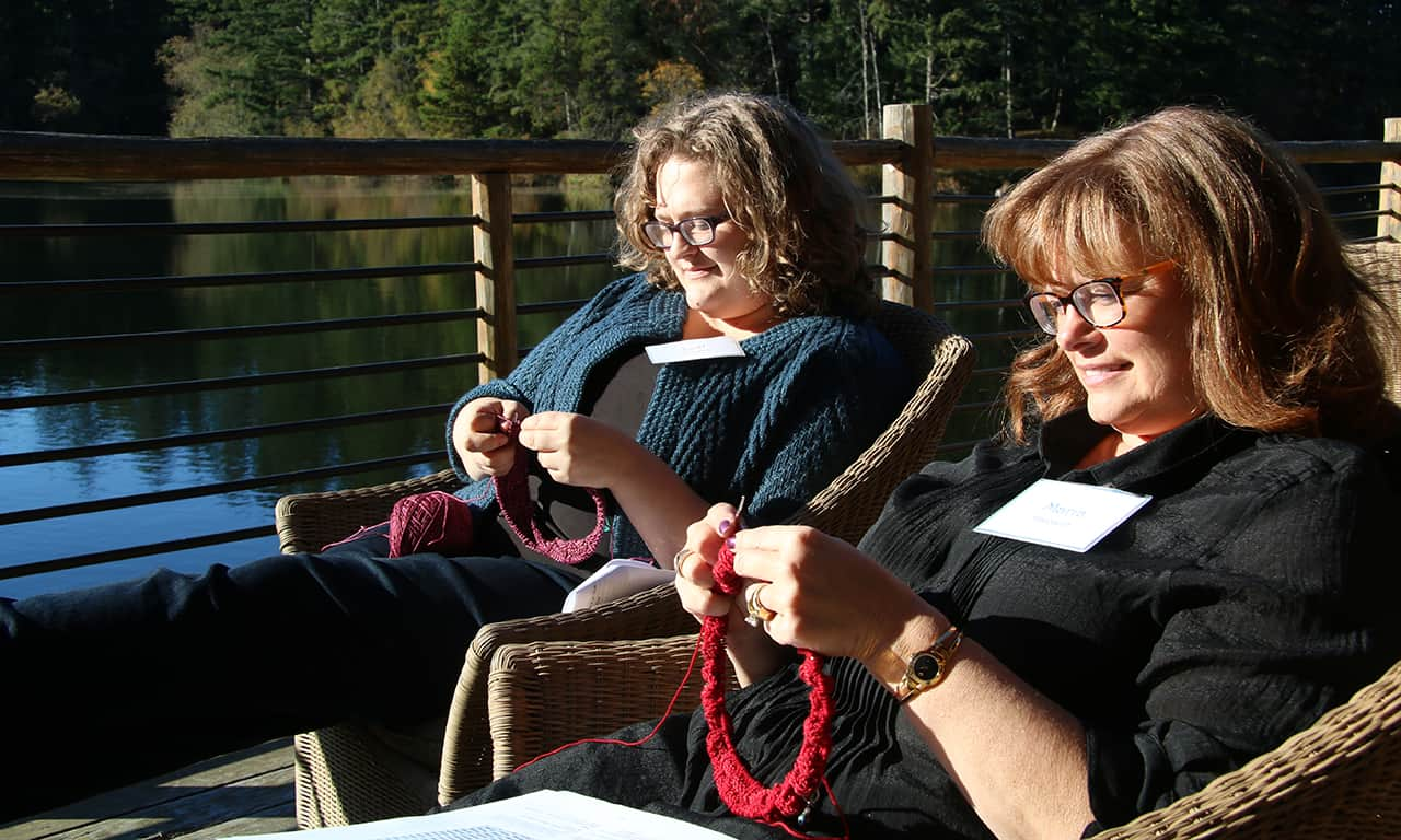 1280 2 knitters on lodge deck