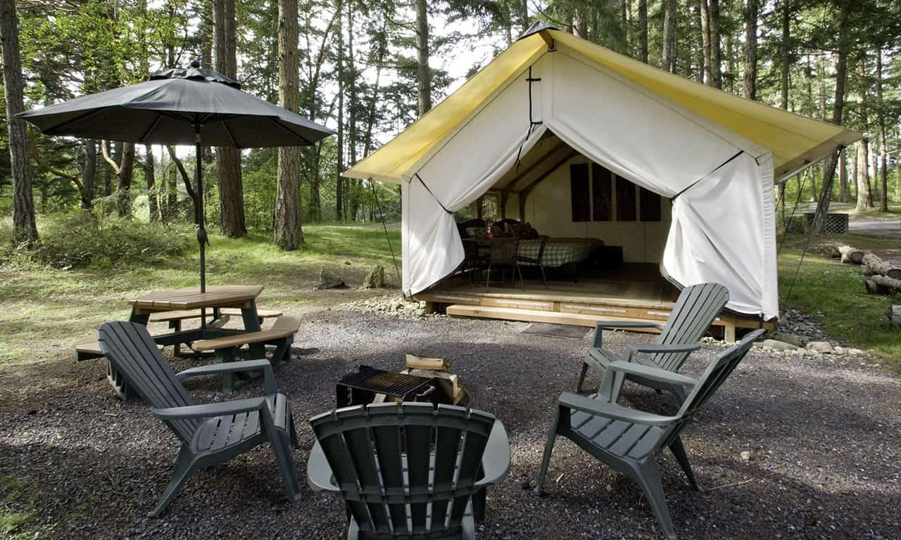 1280 Canvas Cabin bunkhouse exterior with campfire horiz