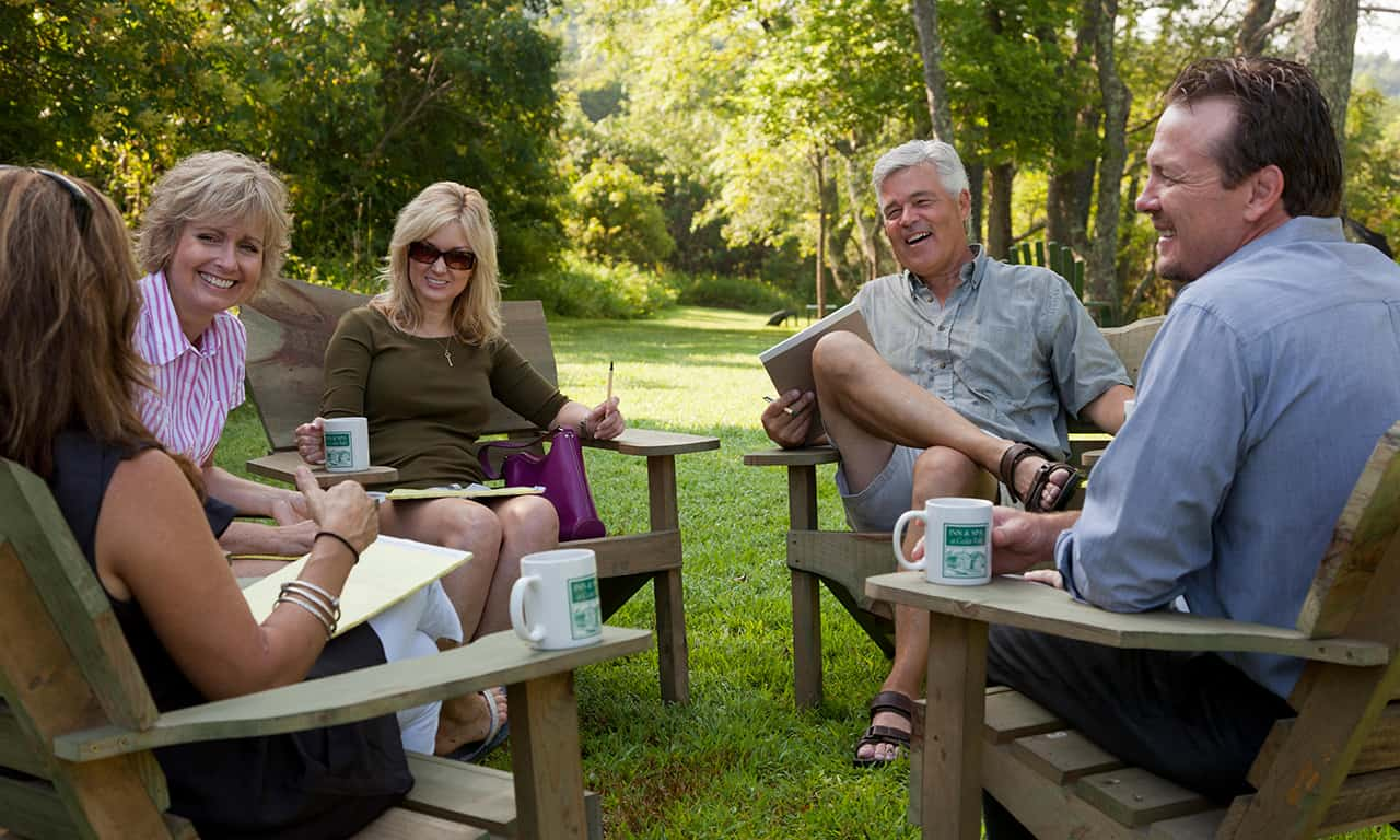 Group of business people meeting outside on corporate retreat. Image shot 2013. Exact date unknown.