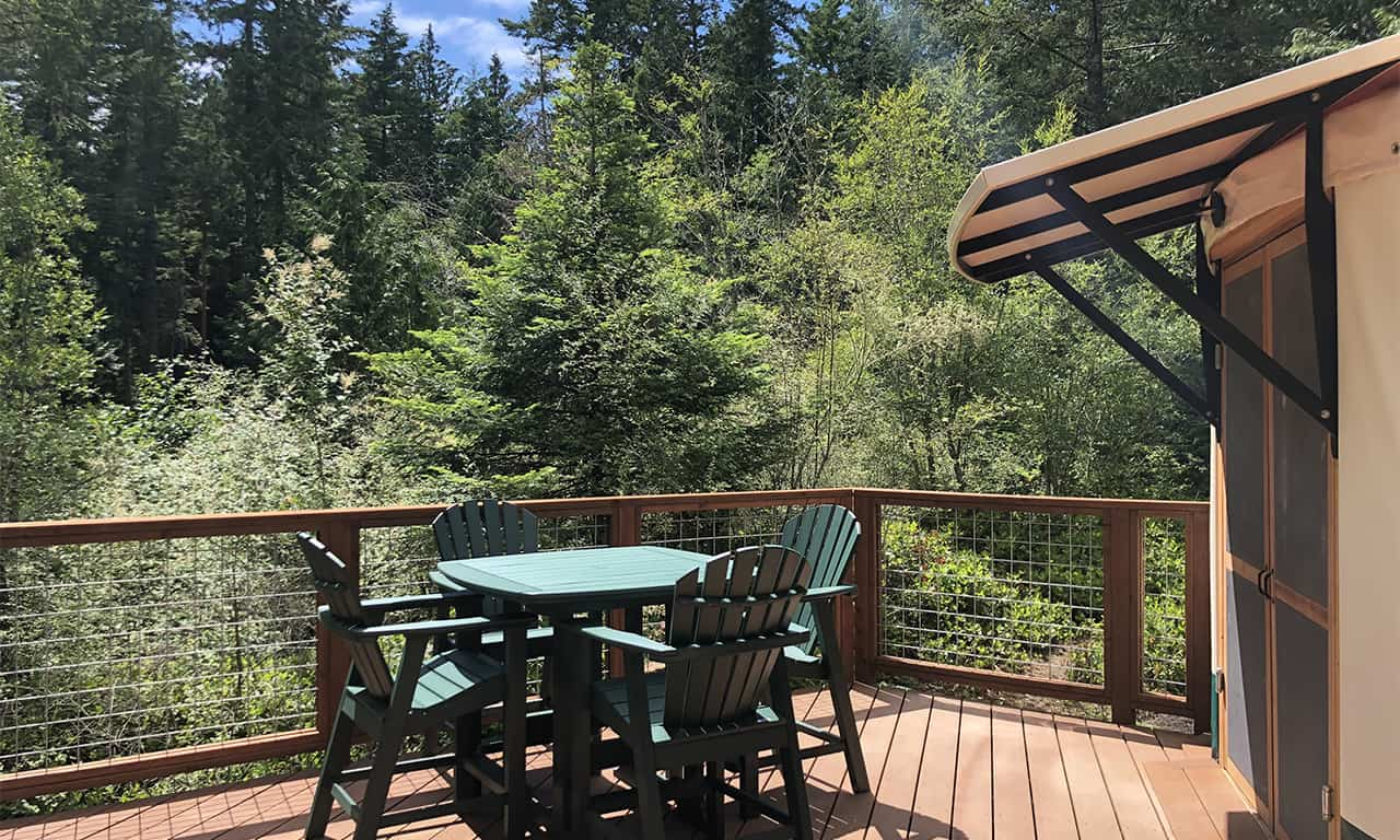 1280 yurt exterior deck 4 with table and chairs