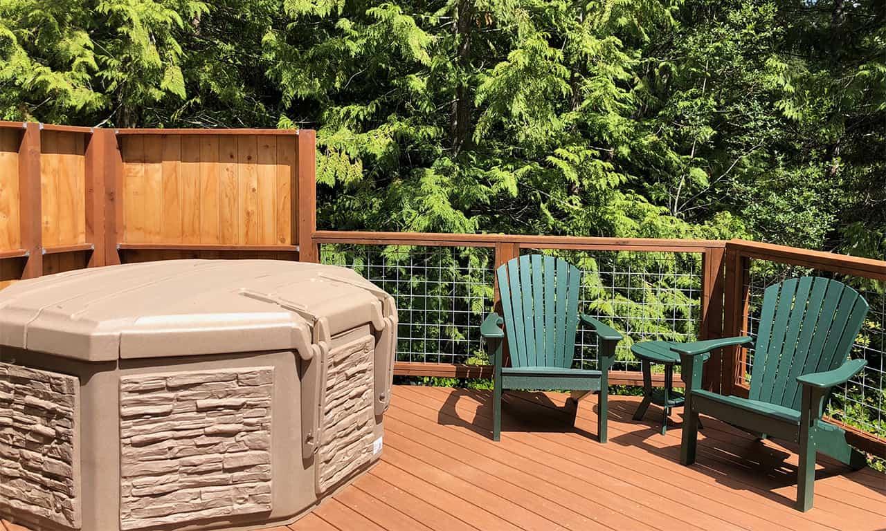1280 yurt exterior hot tub with 2 adirondacks