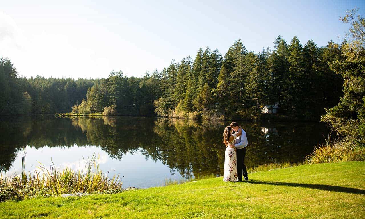 1280-engaged-couple-embracing-by-lake