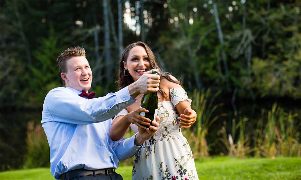 1280-engaged-couple-popping-champagne