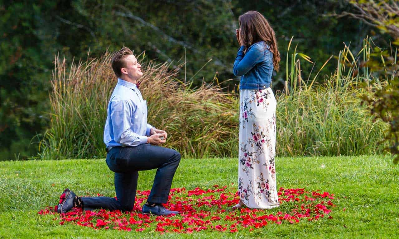 1280-man-proposing-with-rose-petals-on-grass