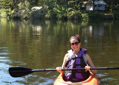 1280-woman-in-kayak-on-lake-with-glamping