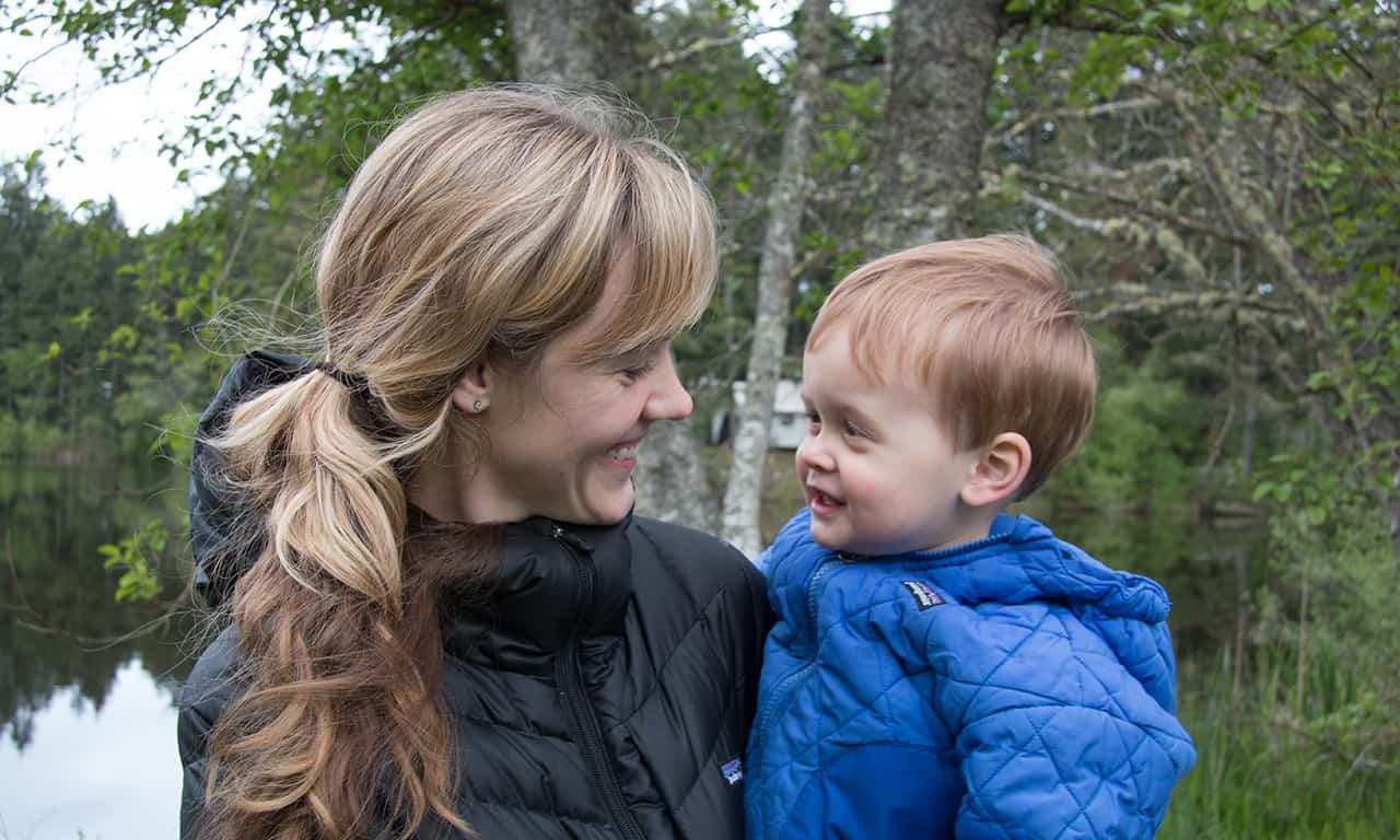 mom and young son at lake