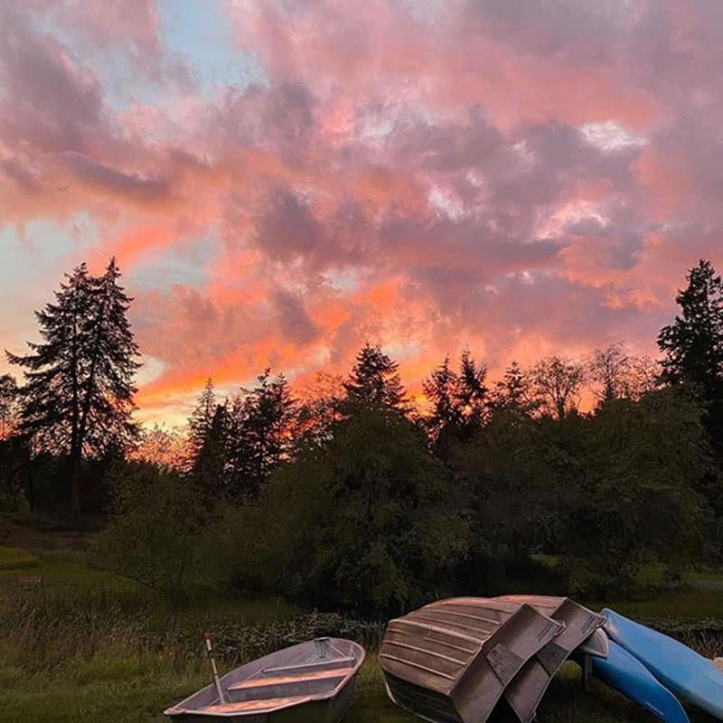 sunset at Lakedale with boats on grass