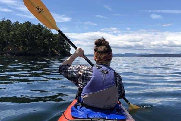 woman kayaking in San Juan Islands