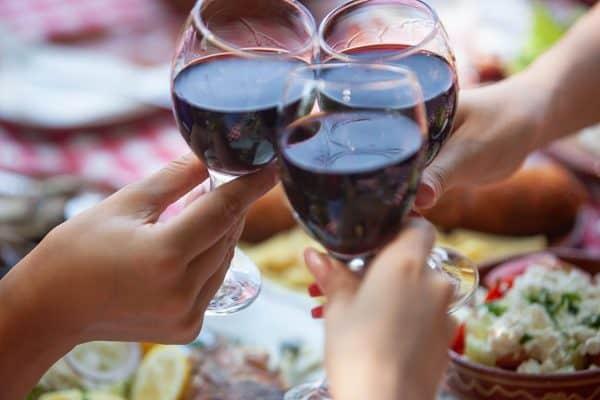 women drinking wine on a getaway