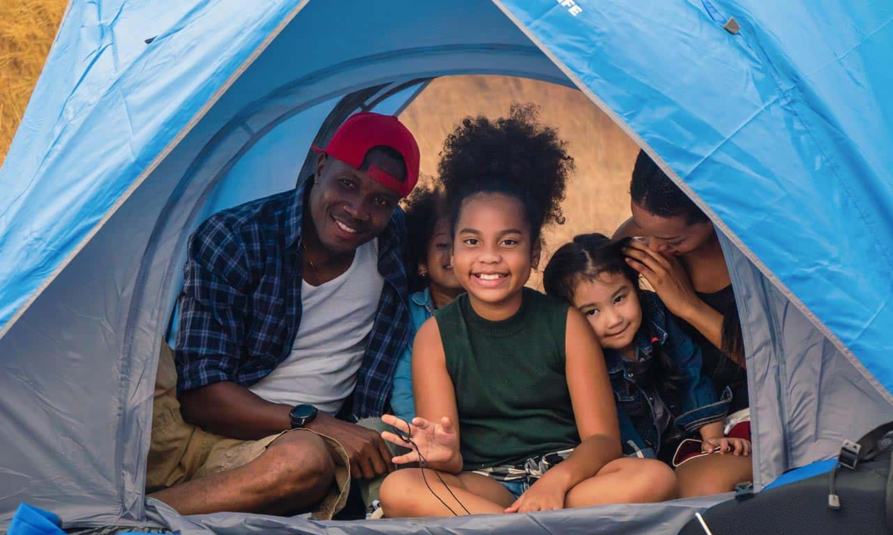 family-camping-in-blue-tent