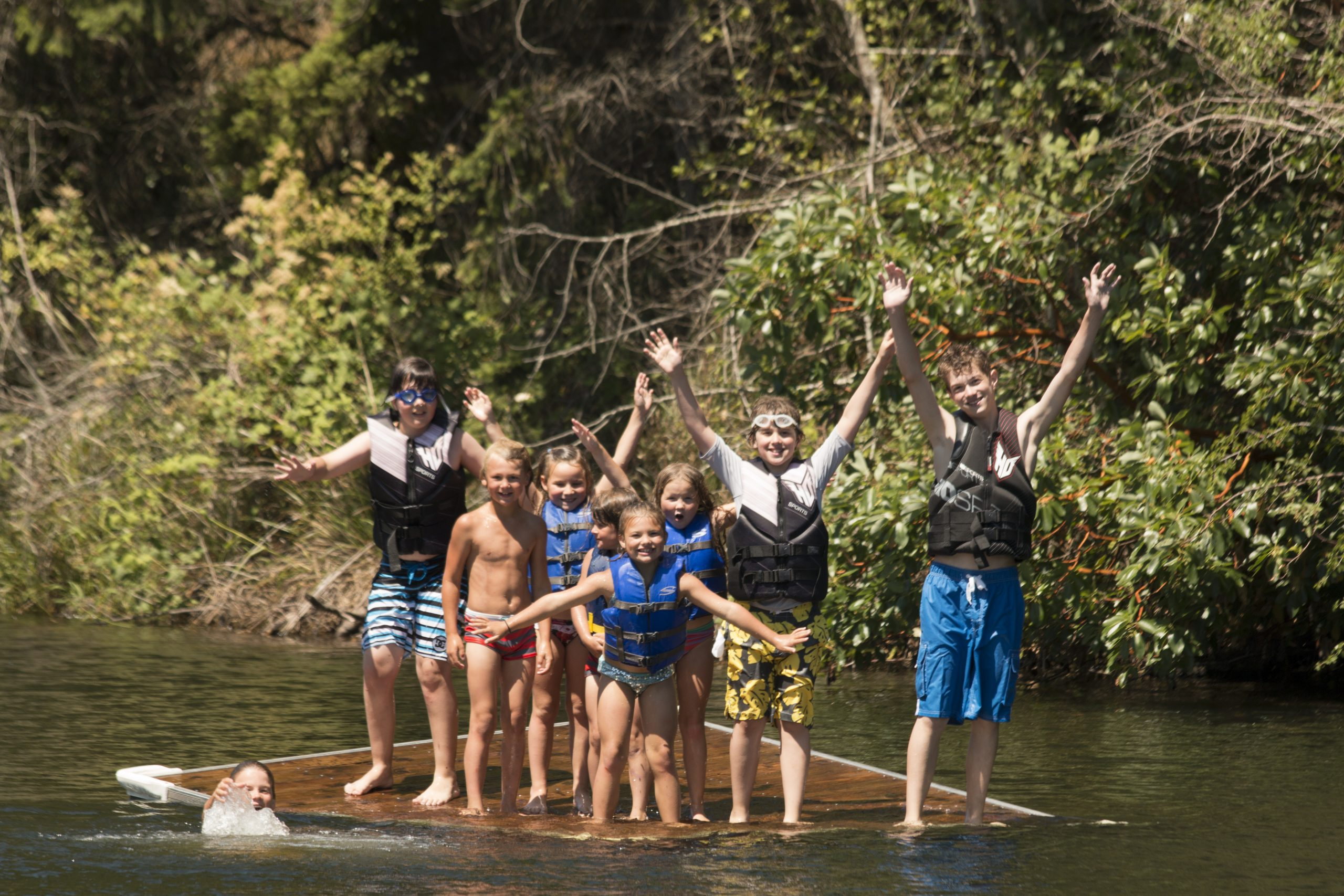 kids jumpng on float at Lakedale