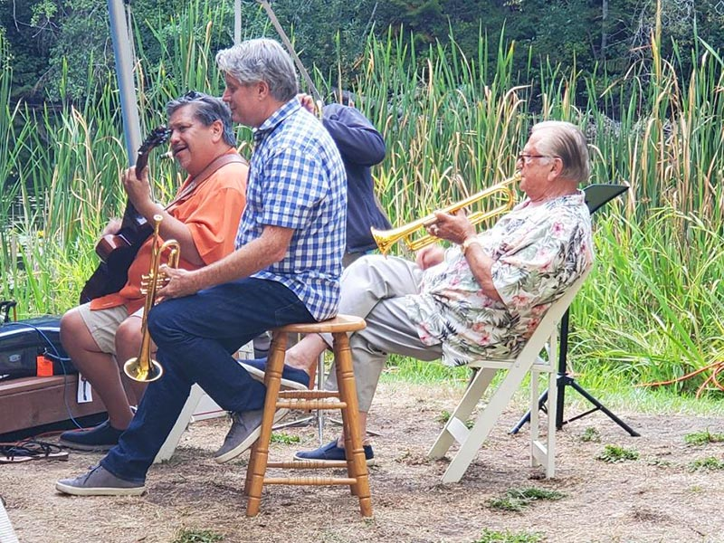 musicians warming up by the lake at the lakedale Music Festival 2021