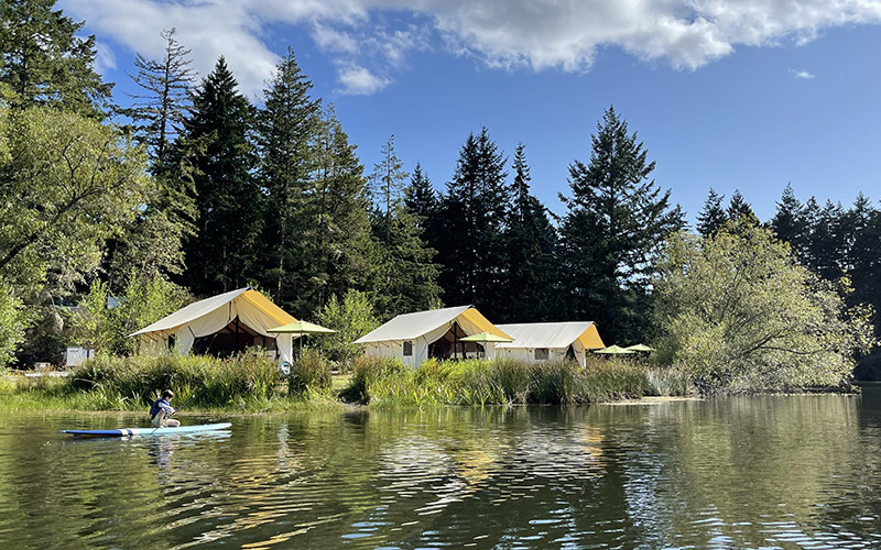 Glamping at Lakedale with boy paddleboarding