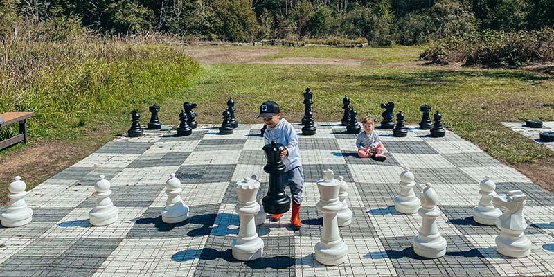 kids playing giant chess at Lakedale on San Juan Island